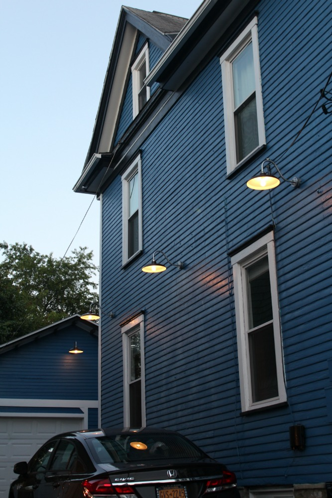 We decided the lights shouldn't be just on the side of the garage but also on the house itself!