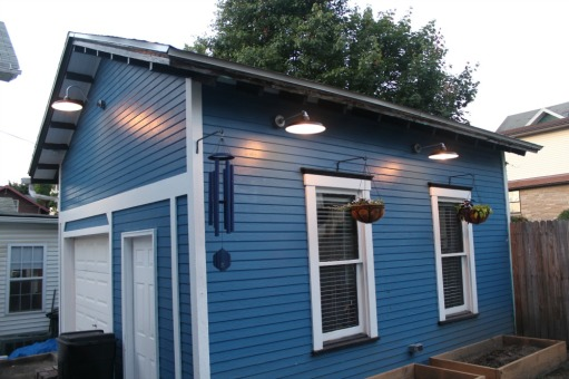I was able to place these wonderful barn style lights on the sides of this garage. We have the lights switched from inside the house so you don't have to go out in the rain in order to turn the lights on!